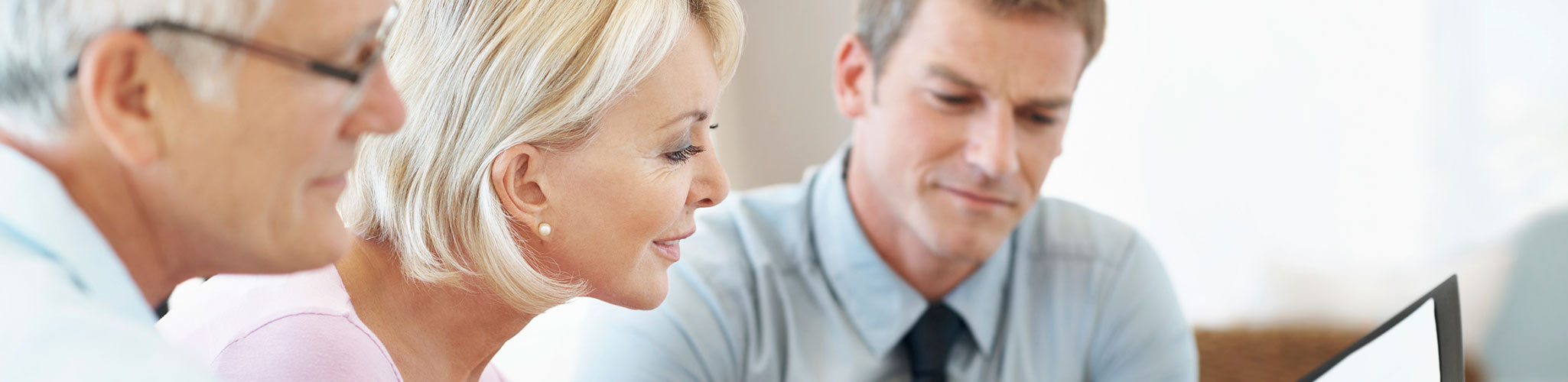 A couple discusses investment options with a financial advisor