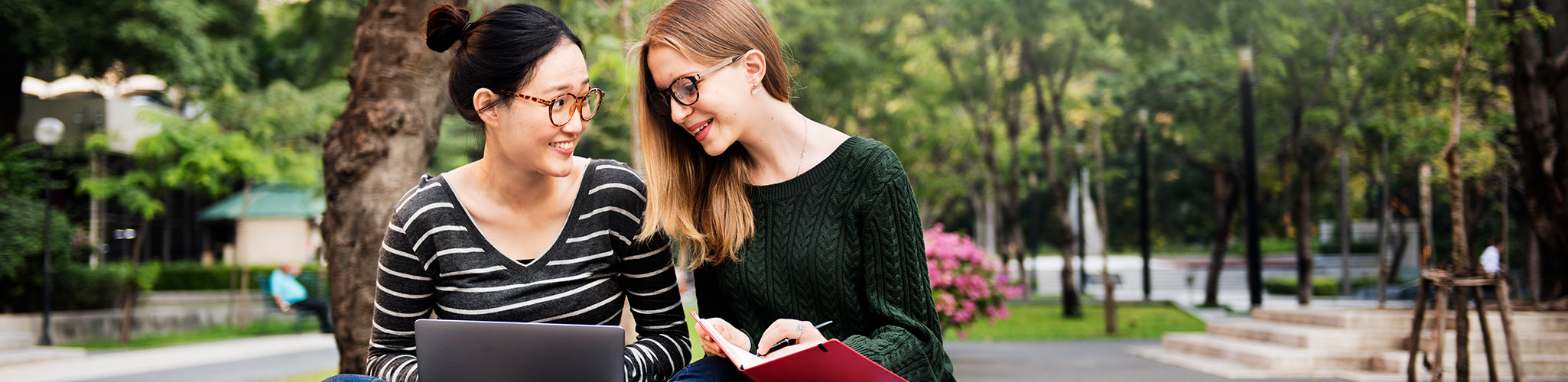 Two students studying on a college campus.